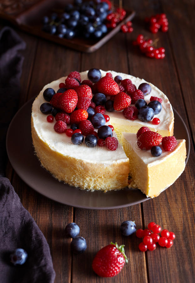 Homemade cheese cake with strawberry and winter berries. New York Cheesecake. Christmas dessert. Healthy food. Homemade cheese cake with strawberry and winter stock photography