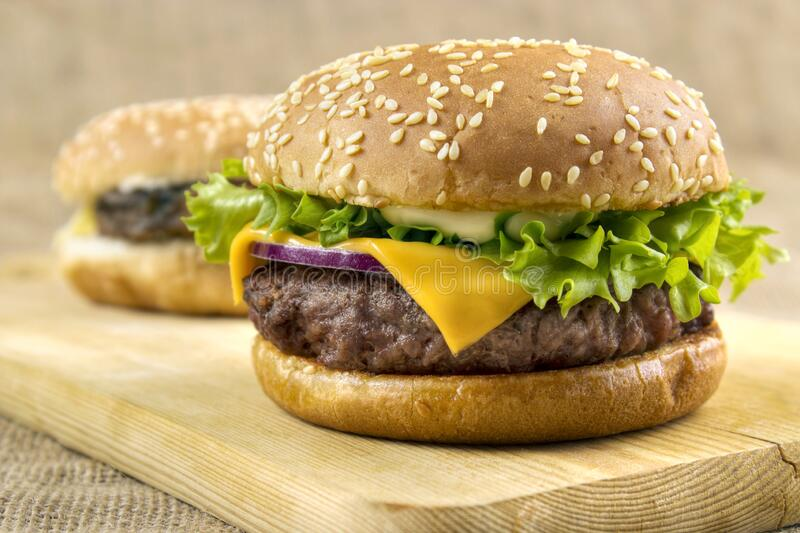Homemade cheeseburgers stock image