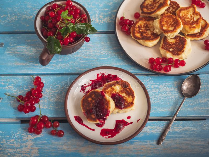 Homemade cheesecakes with red currant berries on a ceramic plate stock image