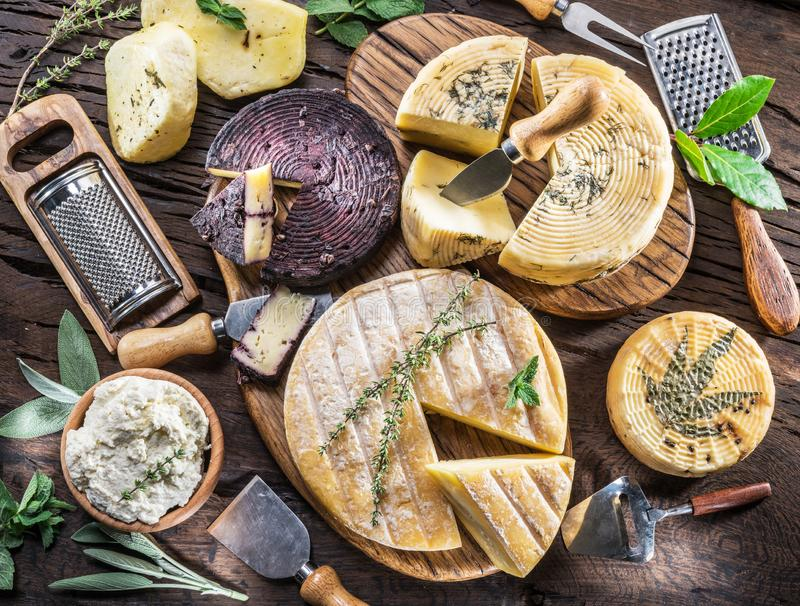 Homemade cheeses on the wooden background. stock images