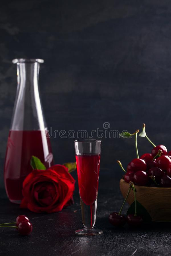Homemade cherry alcohol drink liquor with fresh cherry berries. Homemade cherry alcohol drink liquor with fresh cherry berries royalty free stock image