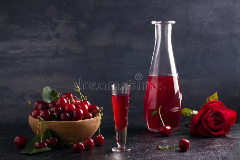Homemade cherry alcohol drink liquor with fresh cherry berries. royalty free stock photos