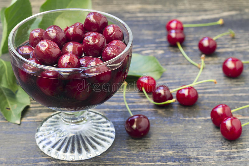 Homemade cherry compote. Glass bowl full of juicy cherry compote stock photos