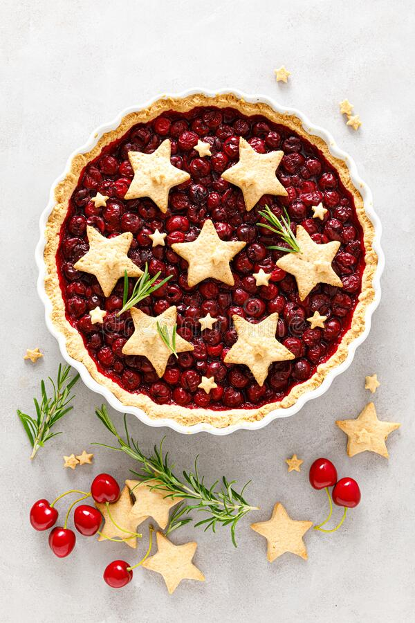 Homemade cherry pie, tart with star shaped cookies stock photography