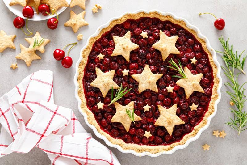 Homemade cherry pie, tart with star shaped cookies stock image