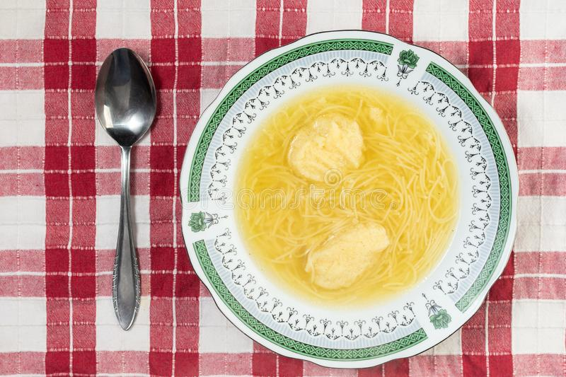 Homemade Chicken Soup with Dumplings served on the table royalty free stock photos