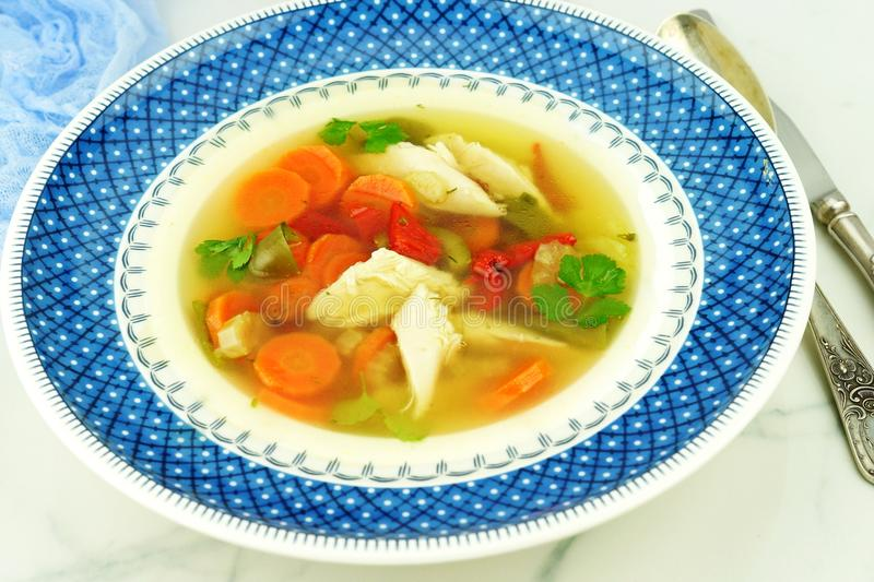 Homemade chicken soup with vegetables and rice in a bowl royalty free stock images