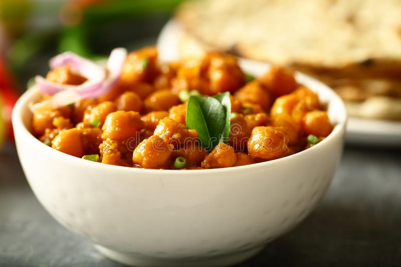 Homemade Chickpea curry served with roti. Indian cuisine. Indian cuisine- homemade chickpea curry,channa masala served with flat breads ,tandoori roti stock photography