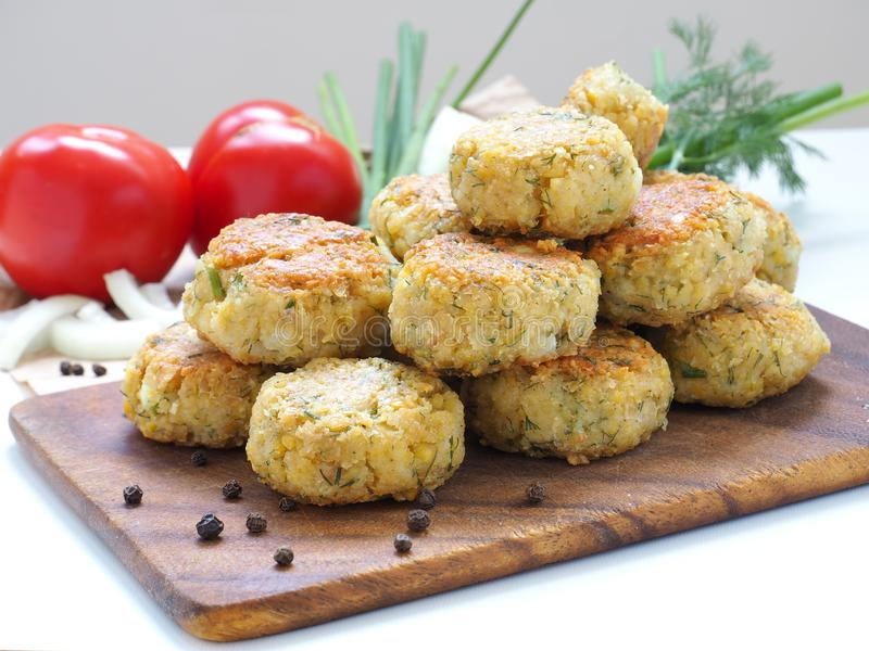 Homemade chickpea Falafel balls on cutting board royalty free stock photos