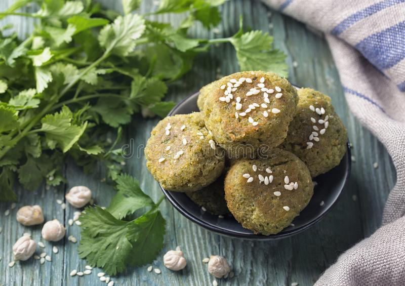 Homemade chickpeas falafel. With coriander in a bowl on a wooden background stock photo