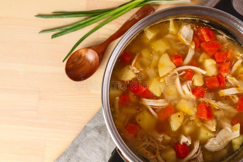 Homemade chiken soup in metal pan stock images