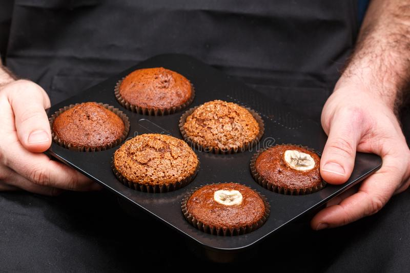 Homemade chocolate, banana and caramel muffins stock photography