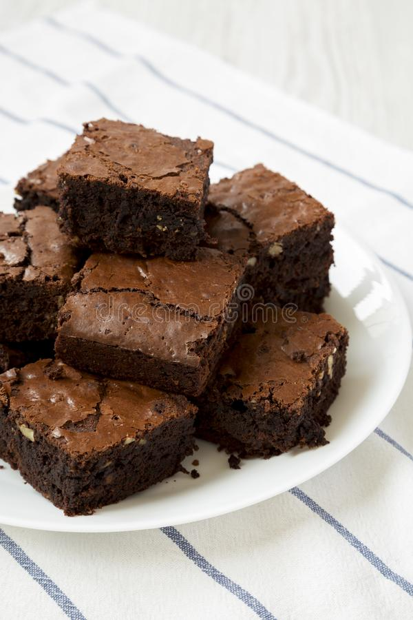Homemade chocolate brownies on a white plate, low angle view. Closeup.  stock image
