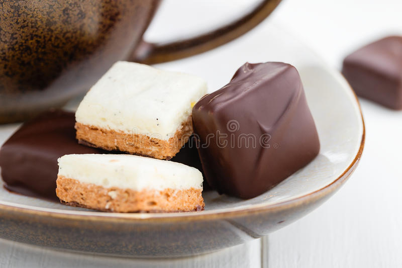 Homemade chocolate candies with vanilla and chocolate soufle. Bi. Homemade vanilla and chocolate souffle candy. Chocolate candy bird`s milk stock photo