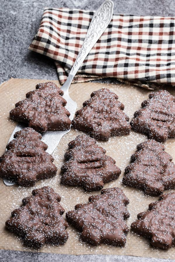 Homemade chocolate Christmas tree cookies on grey stone table royalty free stock images