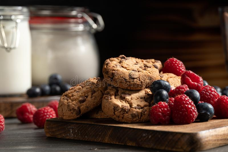 Homemade chocolate cookies with raspberries and blueberies royalty free stock photography