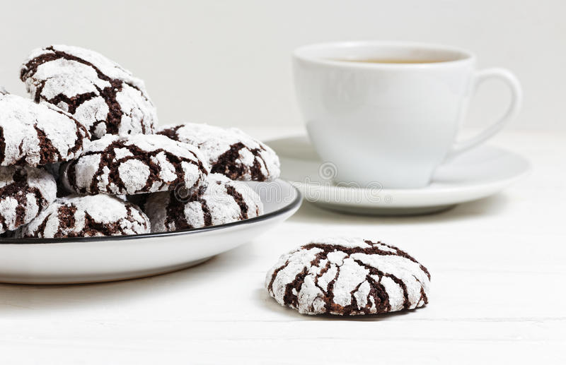 Homemade chocolate crinkles cookies powdered sugar. Closeup homemade chocolate crinkles cookies powdered sugar on white wooden table. Shallow focus stock photography