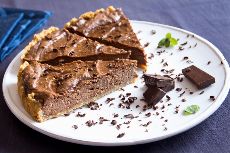 Homemade chocolate pie. (cheesecake) on white plate close up royalty free stock photography