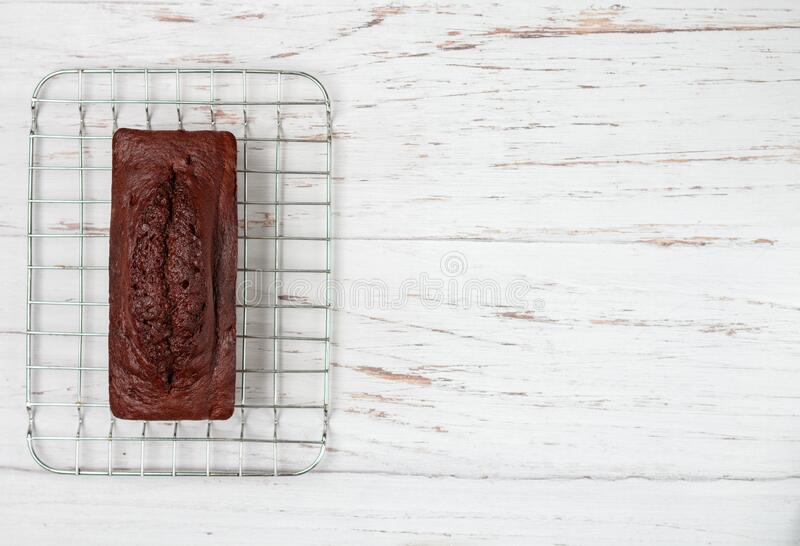 Homemade chocolate pound cake loaf. Delicious dessert for Breakfast. A treat for tea on a light wooden table. Selective focus, copy space stock photo