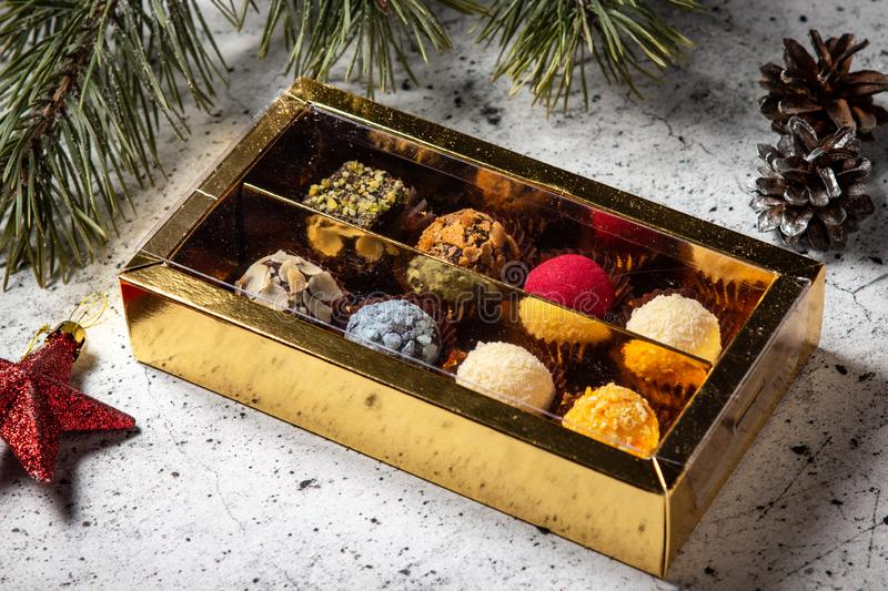 Homemade chocolate truffle candies in a gift box stock photos