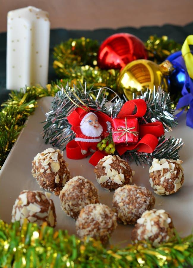 Homemade chocolate truffles with nuts Christmas dessert stock photo