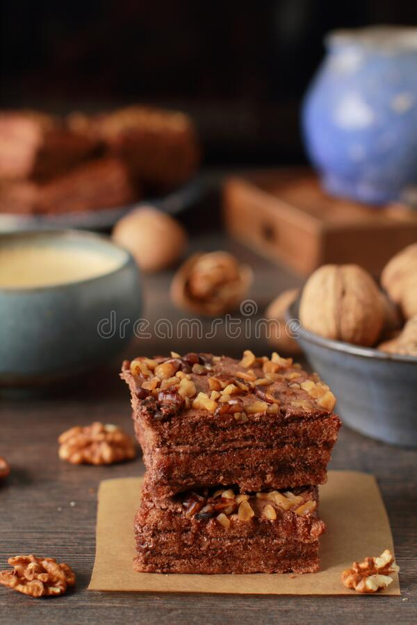 Homemade chocolate and walnuts cake on rustic dark table royalty free stock image