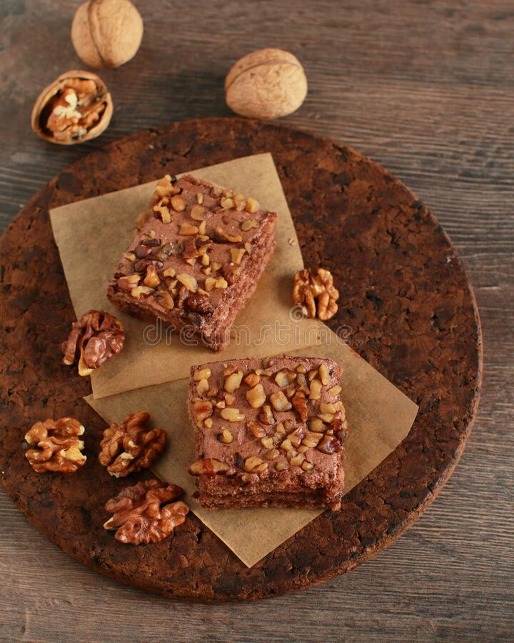 Homemade chocolate and walnuts cake on rustic dark table stock image