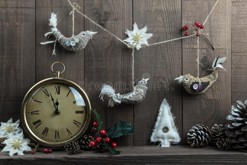 Homemade Christmas bird decorations with vintage clock. Nordic style Christmas arrangement with handmade fabric decorations and a traditional clock Three stock images
