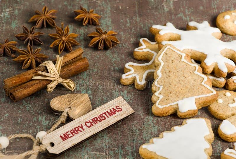 Homemade Christmas biscuits, star anise and cinnamon on rustic b. Traditional homemade Christmas biscuits, star anise and cinnamon on rustic background stock image