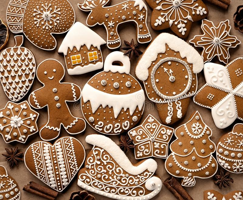 Homemade christmas cookies on brown paper. Delicious art gingerbread with 2020 lettering on brown paper background. Top view royalty free stock photography