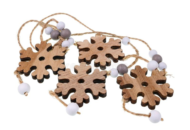 Homemade Christmas female beads are made of made of wooden snowflakes and pearls stock photo