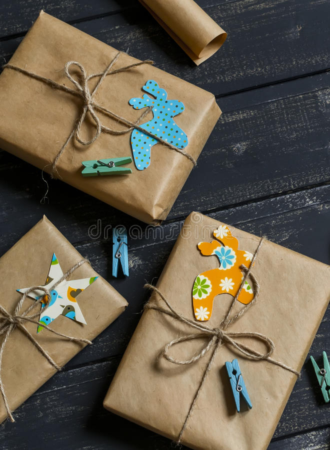 Homemade Christmas gifts in kraft paper royalty free stock photos