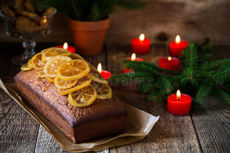 Homemade christmas lemon cake. Topped with candied fruits on rustic wooden table royalty free stock photography