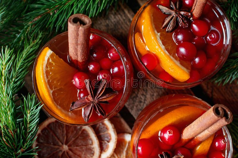 Homemade Christmas mulled red wine with spices, cinnamon and citrus fruit on rustic wooden background, traditional winter hot drin royalty free stock photo