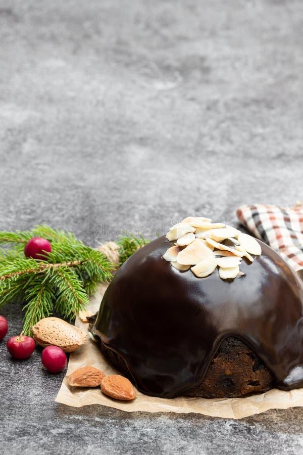 Homemade Christmas pudding on gray stone background stock photography