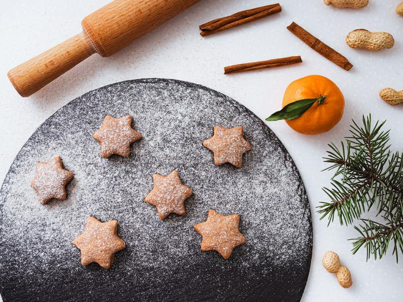 Homemade Christmas shortbread star shape sugar cookies with sugar powder, cinnamon, green fir tree and cookie. Christmas royalty free stock images