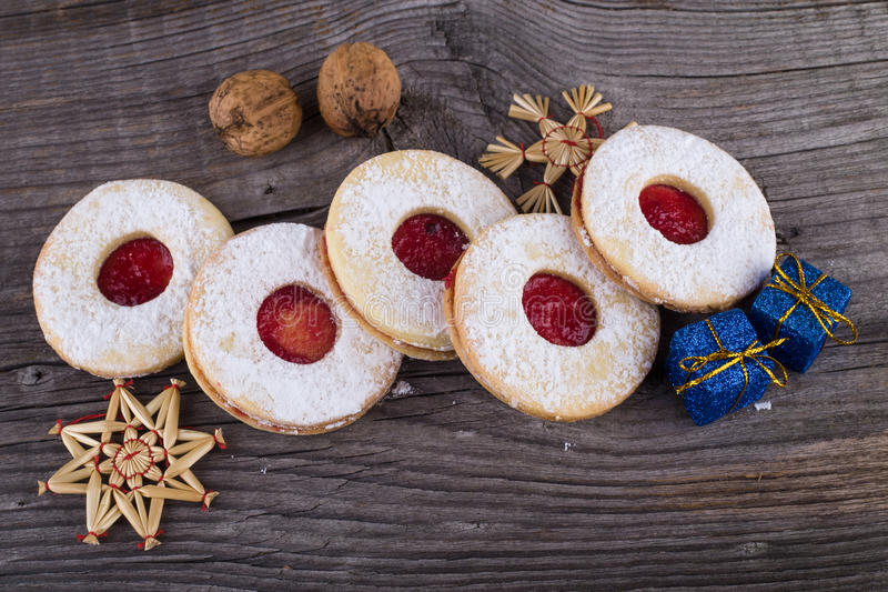 Homemade Christmas sweets with sugar powder and jam stock images