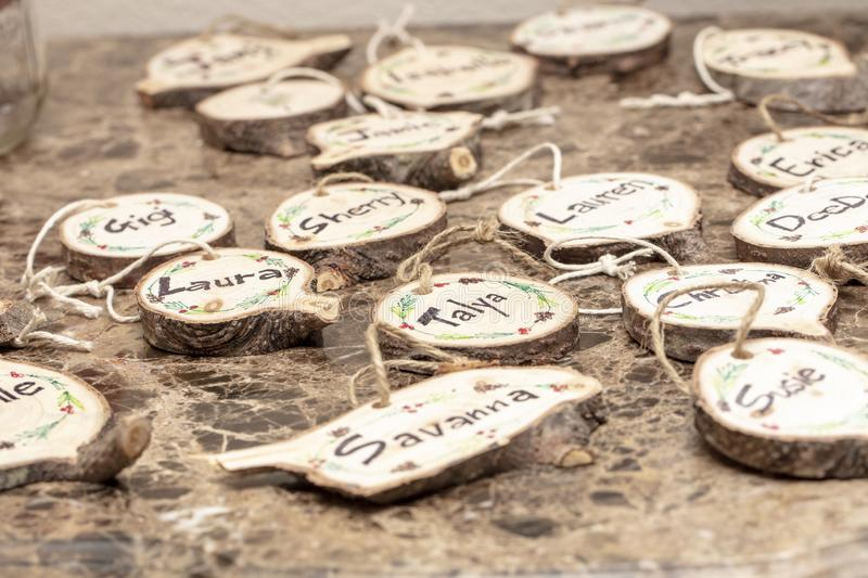 Homemade Christmas Tree Decorations. Homemade Christmas tree decoration made from tree trunk and branches with names painted on the face of the wood royalty free stock photos