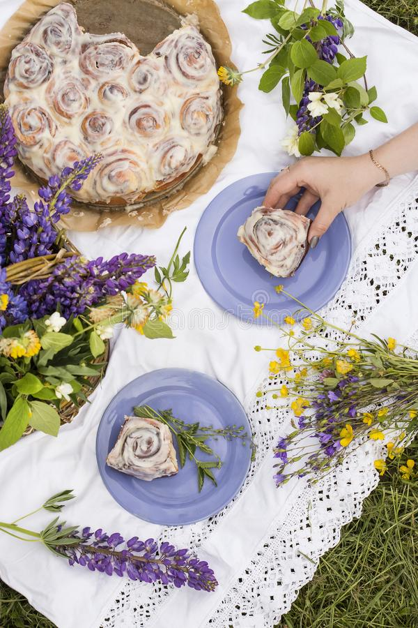Homemade Cinnabon buns at summer picnic stock images