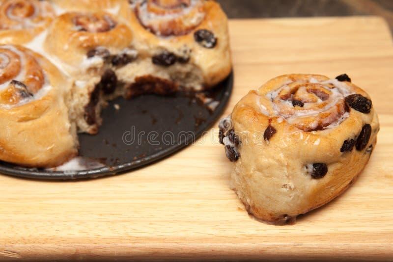 Homemade cinnamon swirls cooling on a rack. Homemade tear and share cinnamon swirl bread rolls stock photos