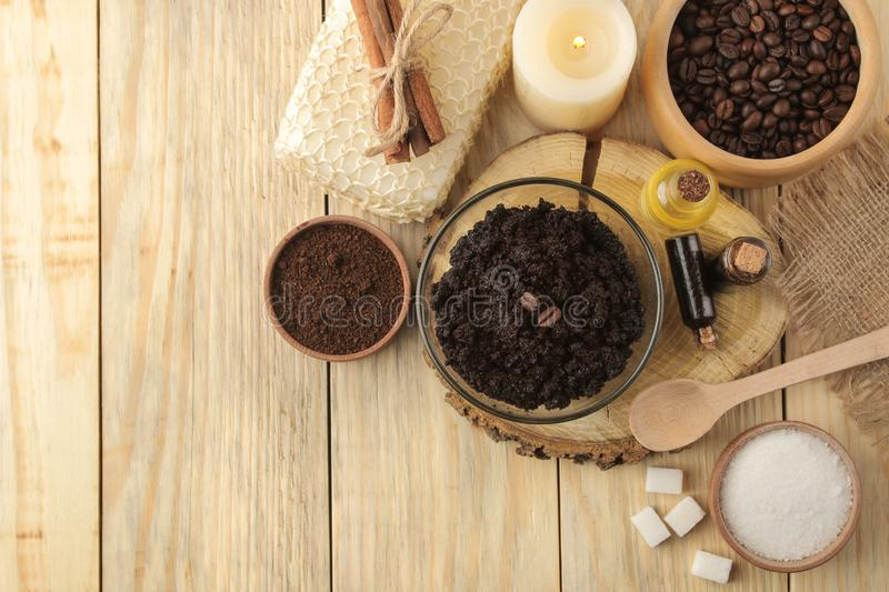 Homemade coffee scrub in the face and body bowl and various ingredients for making scrub on a wooden table. spa. cosmetics. care c stock images
