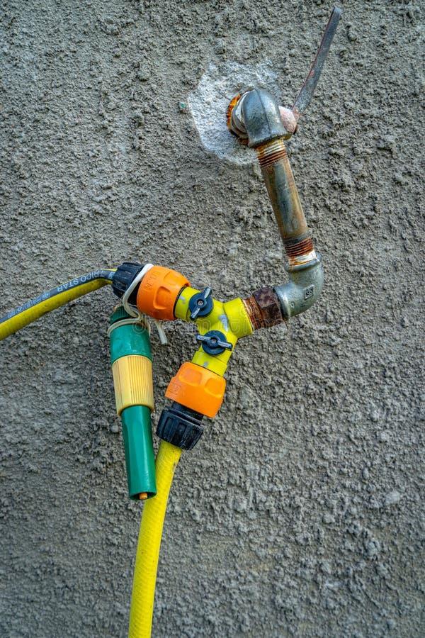 Homemade water tap splitter joint stock photos