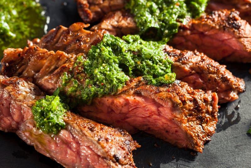 Homemade Cooked Skirt Steak with Chimichurri stock photo