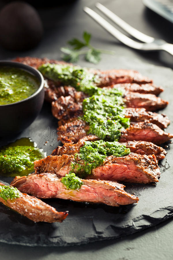 Homemade Cooked Skirt Steak with Chimichurri. Sauce and Spices stock photography