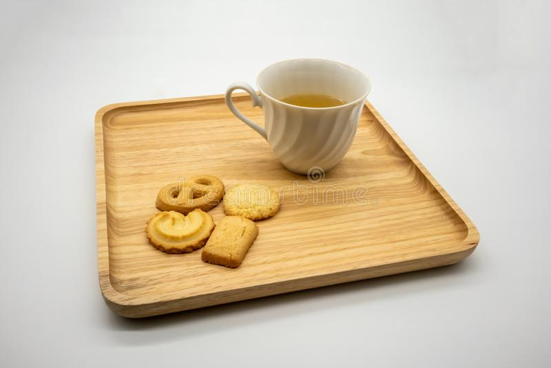 Homemade cookie and tea on wooden tray isolated on white stock photography