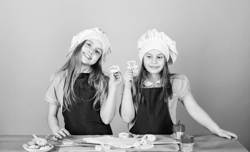Homemade cookies best. Kids baking cookies together. Kids aprons and chef hats cooking. Family recipe. Culinary. Education. Mothers day. Baking ginger cookies royalty free stock image