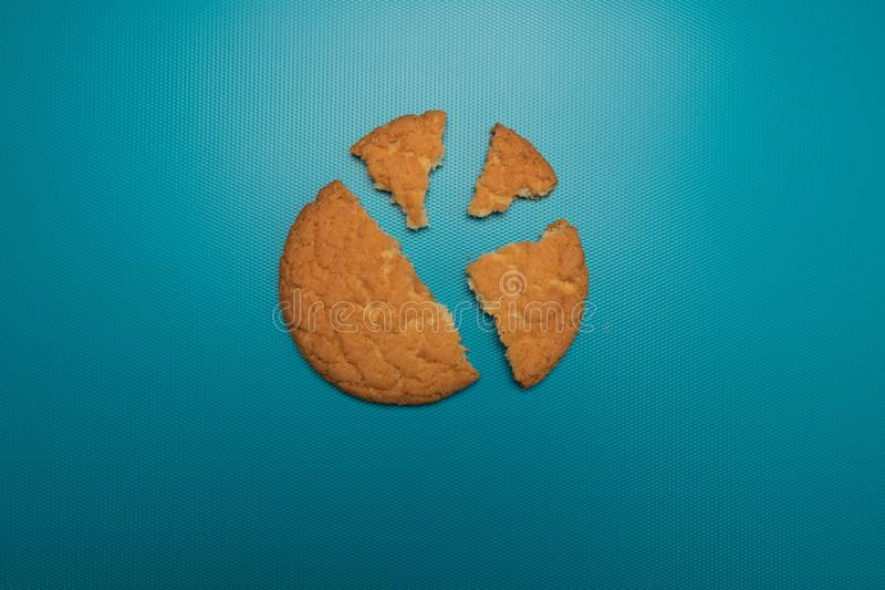 Cookies studio image. Homemade cookies on a blue background. Appetizing homemade cakes. Broken cookie. Bitten biscuits. Homemade cookies on a blue background royalty free stock photo