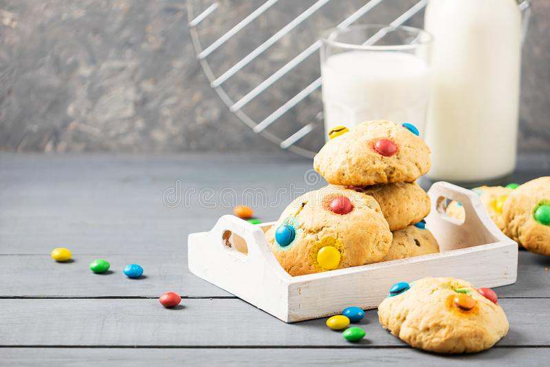 Homemade cookies decorated with multi-colored sweets dragees in a stack on a gray table background. Copy space. royalty free stock images
