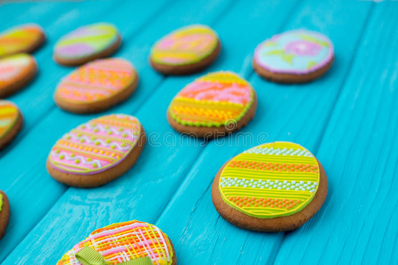 Homemade cookies with icing in the shape of an egg for Easter. Delicious Easter cookies on a blue background. Cooki royalty free stock photo