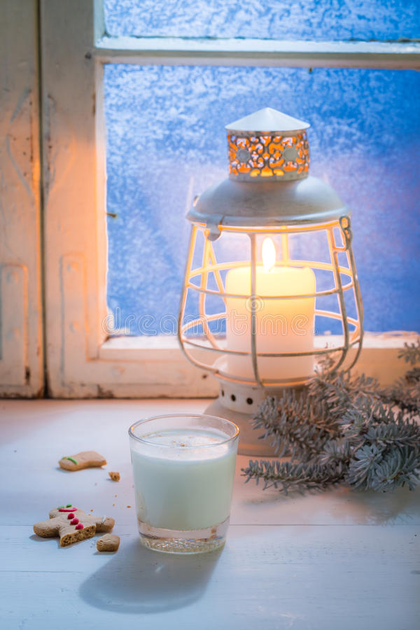 Homemade cookies with milk for Christmas at cold night. On white table stock photography